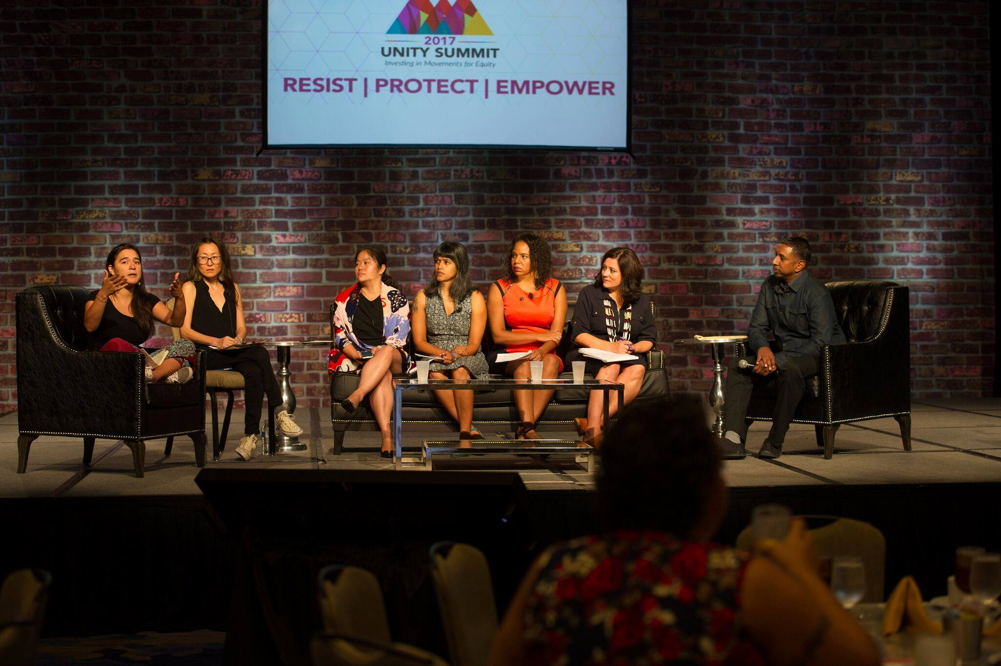 Photo, courtesy of Change Philanthropy Facebook page, depicts a plenary discussion at the 2017 Unity Summit.